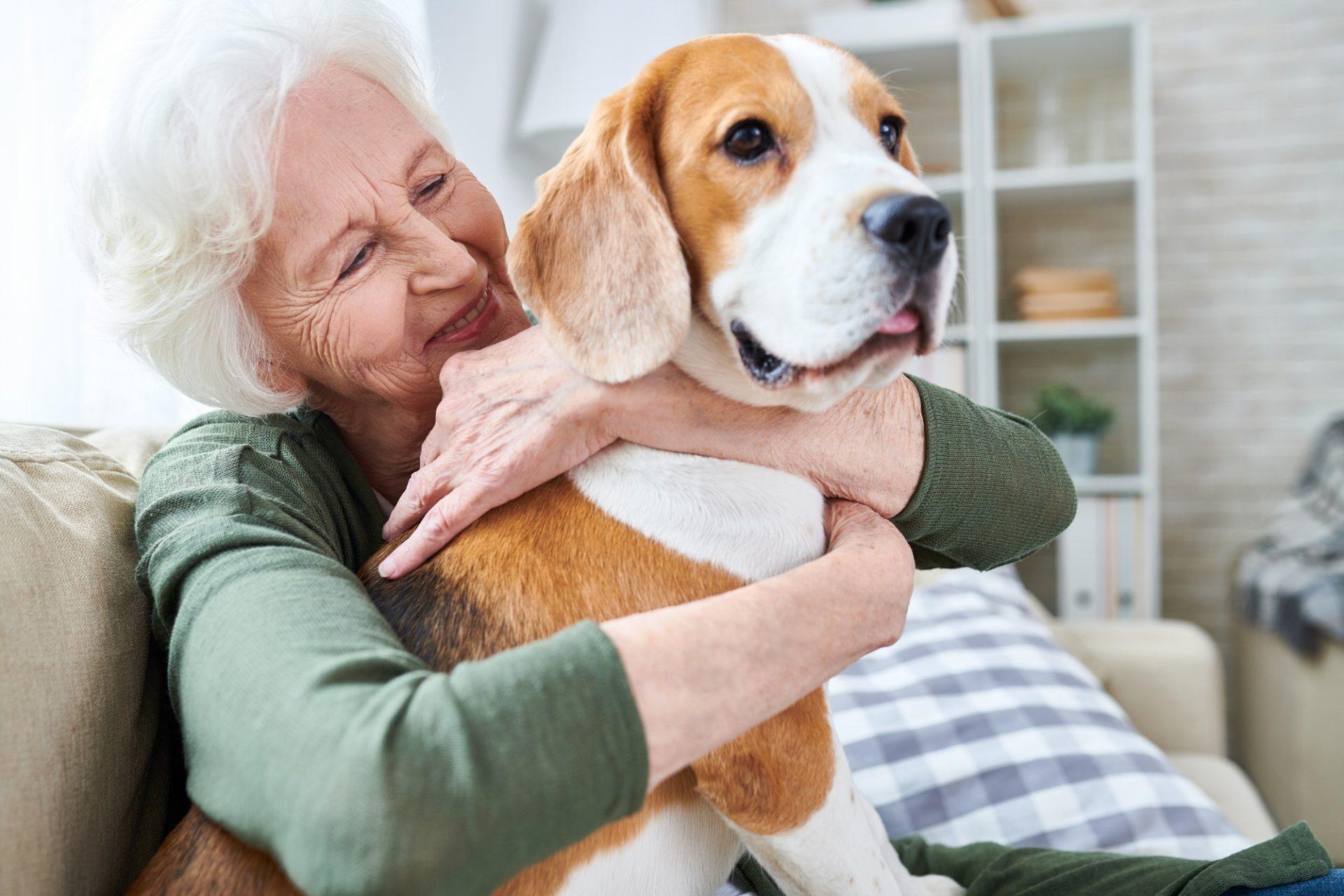 Happy granny loving her dog